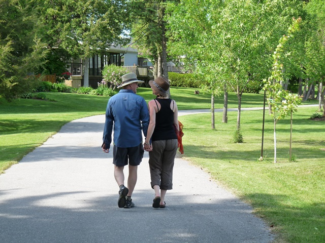 Couple holding hands and walking along the trail